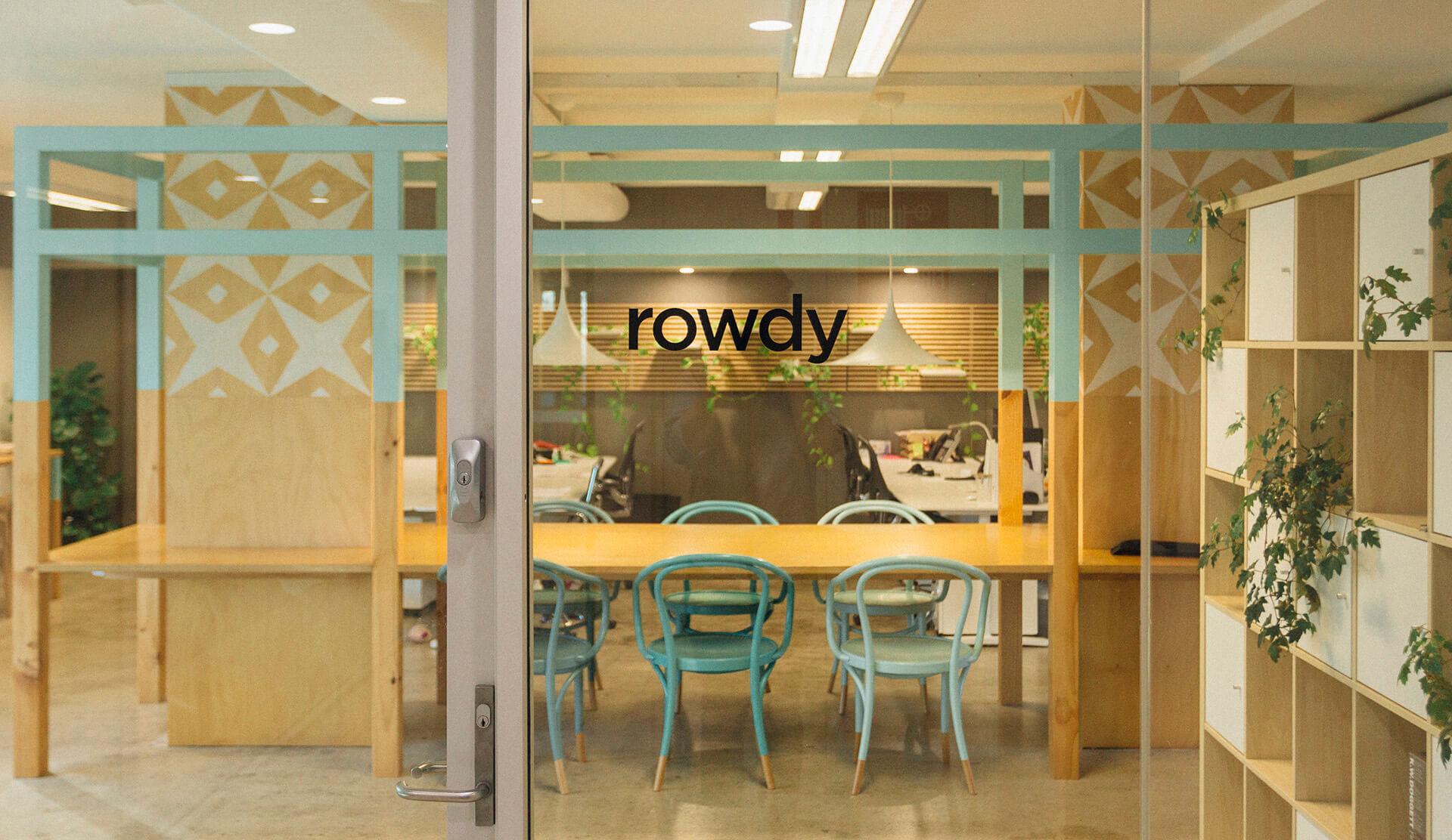 Window looking inside of the Rowdy Inc office